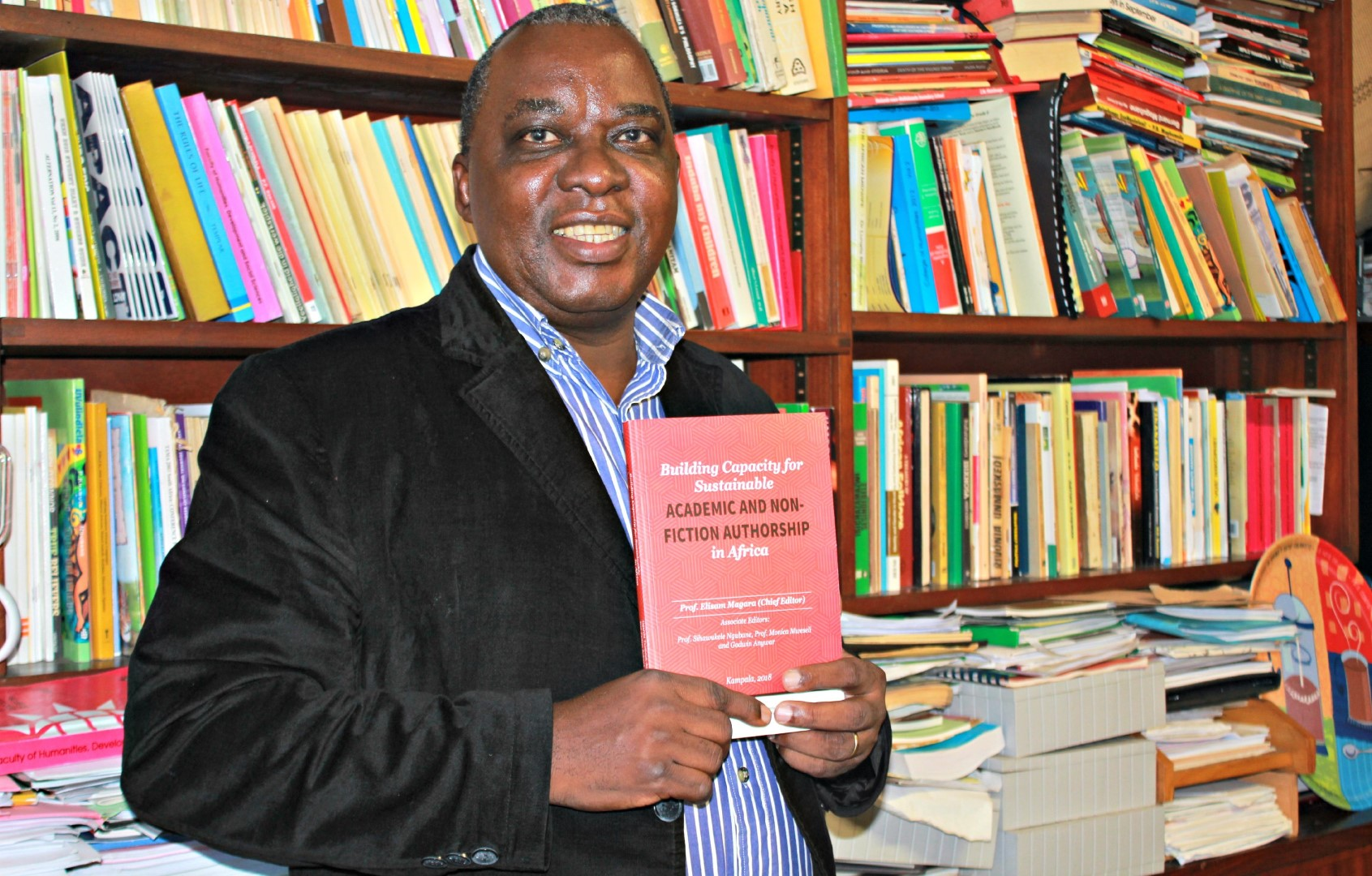 Professor Sihawukele Ngubane with his book, Building Capacity for Sustainable Academic and Non-Fiction Authorship in Africa.